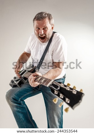 portrait of a guitar player - stock photo