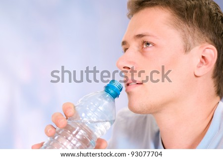 portrait of a guy with bottle of water