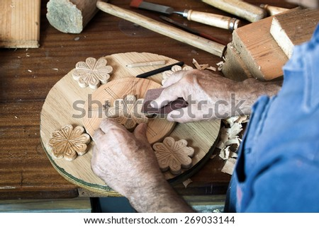 portrait of a hands carpenter planing on composition of wood at work in the workshop / cabinetmaker's hands using sandpaper on a piece of wood - stock photo