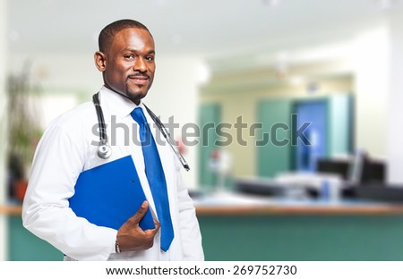 Portrait of a handsome African doctor - stock photo
