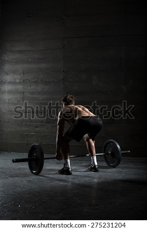 Portrait of a handsome athlete from behind - stock photo