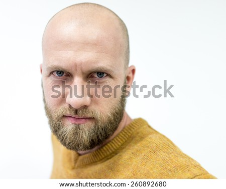 Portrait of a handsome bald young man with beard - stock photo