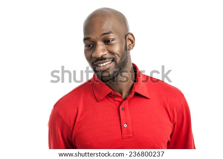 Portrait of a handsome black man in his 20s looking away isolated on a white background