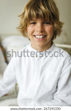 Portrait of a handsome blond boy - stock photo