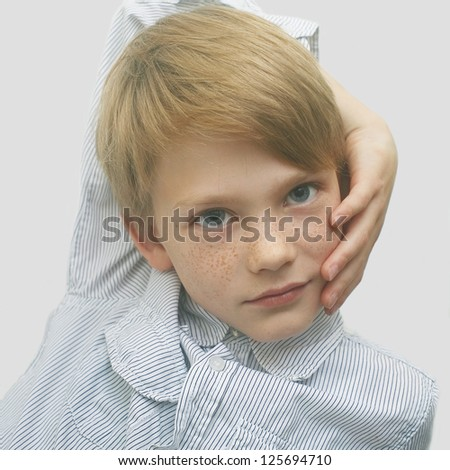 portrait of a handsome boy with freckles, art close-up portrait - stock photo