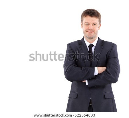 Portrait of a handsome business man  in suit smiling with arms