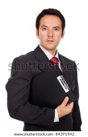 Portrait of a handsome business man standing with binder. Isolated on white.