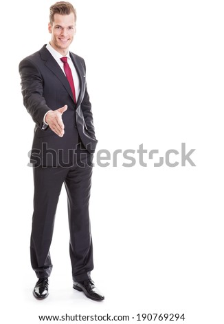 Portrait of a handsome businessman giving an handshake - full length shot, completely isolated on white background