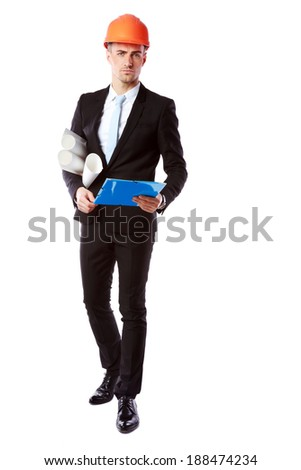 Portrait of a handsome businessman in helmet with blue folder over white background - stock photo
