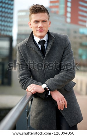 Portrait of a handsome businessman standing outside - stock photo