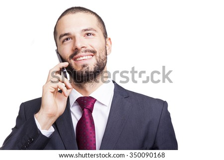 Portrait of a handsome businessman talking on the phone, isolated on white background