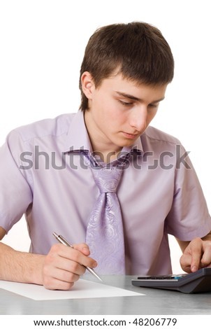 portrait of a handsome businessman with a calculator on a white background