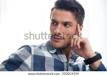 Portrait of a handsome casual man looking away isolated on a white background