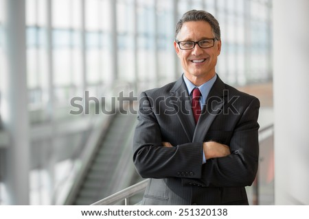 Portrait of a handsome CEO smiling  - stock photo