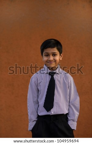 portrait of a handsome child executive - stock photo