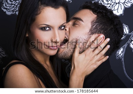 Portrait of a handsome couple kissing