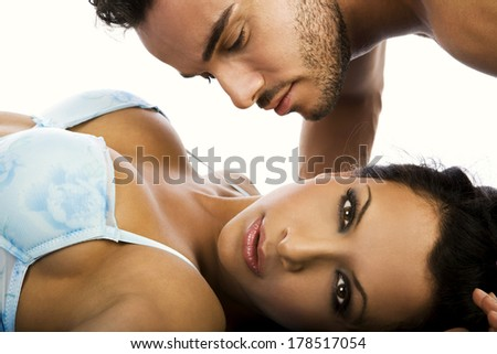 Portrait of a handsome couple kissing  - stock photo