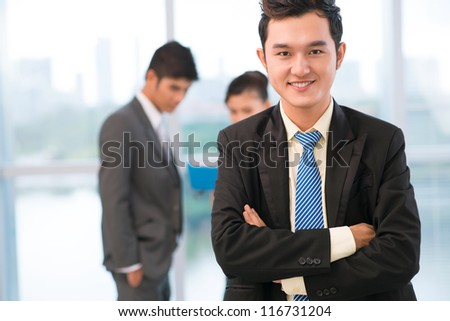 Portrait of a handsome guy being successful in business - stock photo