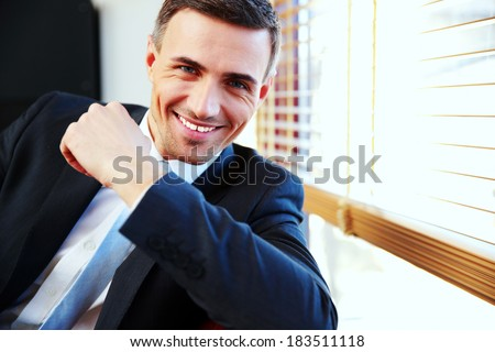 Portrait of a handsome happy businessman in suit - stock photo