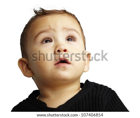 portrait of a handsome kid looking up against a white background
