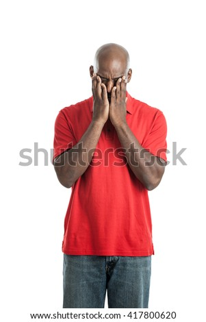 Portrait of a  handsome late 20s black man with head in hands with headache isolated on a white background - stock photo