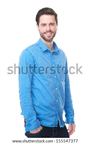 Portrait of a handsome male fashion model smiling in blue jeans and shirt
