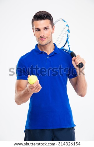 Portrait of a handsome male tennis player standing isolated on a white background and looking at camera - stock photo