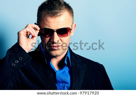 Portrait of a handsome man in a suit. Studio shot. - stock photo