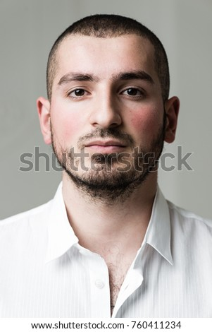 Portrait of a handsome man in a white shirt