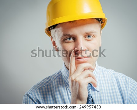 Portrait of a handsome man in a yellow construction helmet  - stock photo