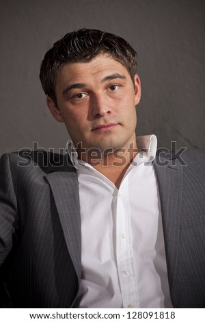 Portrait of a handsome man in business suit - stock photo