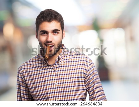portrait of a handsome man smoking a cigar - stock photo