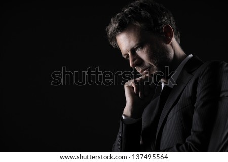 Portrait of a handsome mature man lost in deep thought - stock photo