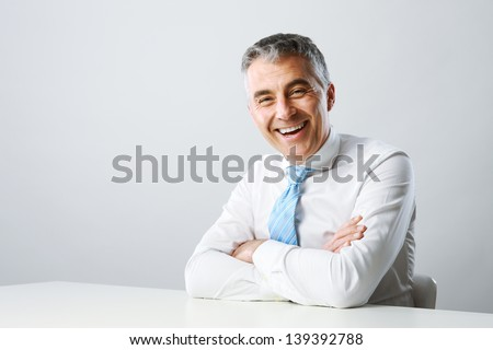 Portrait of a handsome mature man smiling - stock photo