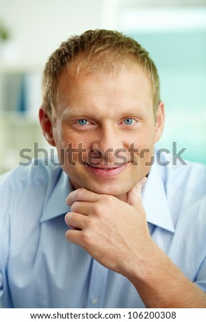 Portrait of a handsome mature man smiling and looking happy - stock photo