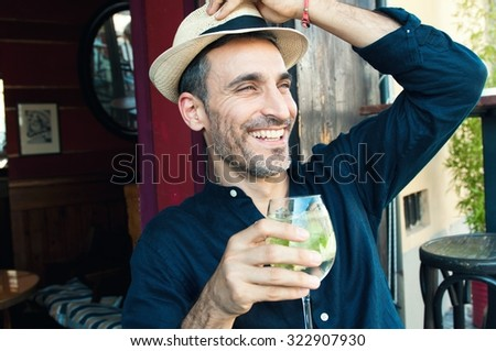 Portrait of a handsome middle age man enjoying a beautiful day at the bar - stock photo
