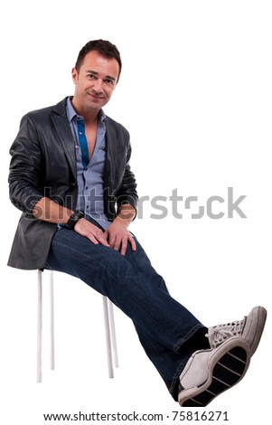 Portrait of a handsome middle-age man , sitting on a bench, isolated on white  background