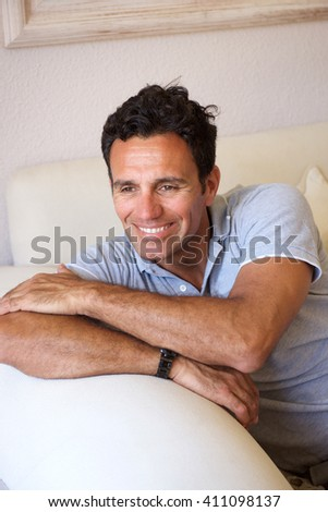Portrait of a handsome middle aged guy smiling at home