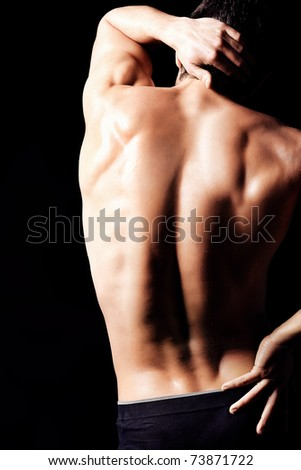 Portrait of a handsome muscular young man. Shot in a studio.