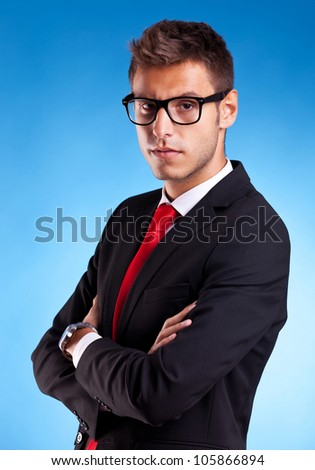 Portrait of a handsome serious young business man in suit over white background - stock photo