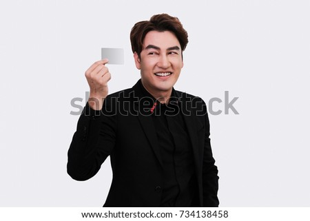 Portrait of a handsome smiling business man, holding a card on right hand, isolated on white background