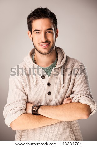 Portrait of a handsome smiling young man. - stock photo
