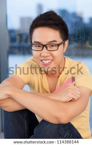 Portrait of a handsome student boy - stock photo