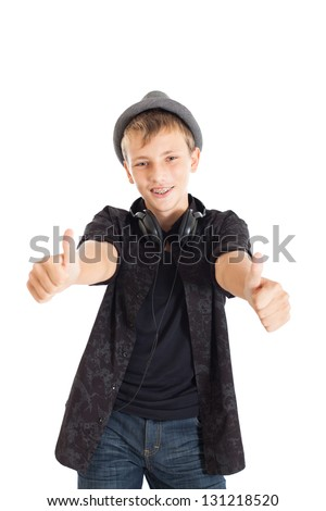 "Portrait of a Handsome teen boy wearing a European black shirt and hat. The boy shows signs of ""Excellent"". Studio shot, isolated on white background. - stock photo"