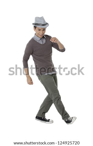 Portrait of a handsome teenager dancing in a white background