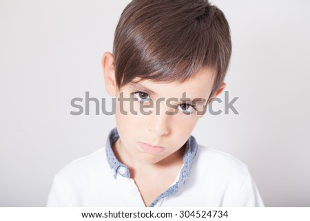 Portrait of a handsome upset boy - stock photo