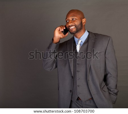 Portrait of a handsome young African American business man - stock photo