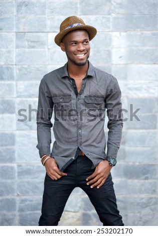 Portrait of a handsome young african american man smiling with hat - stock photo