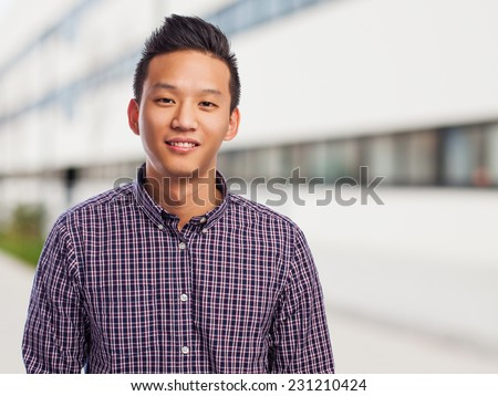 portrait of a handsome young asian man - stock photo