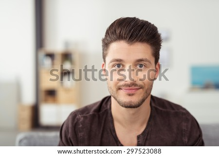 Portrait of a Handsome Young Bearded Guy Looking at the Camera with a Happy Facial Expression. - stock photo